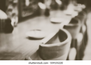 Blurred  background abstract and can be illustration to article of Fine table setting in gourmet restaurant