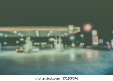 Blurred  background abstract and can be illustration to article of Petrol pump filling in night
