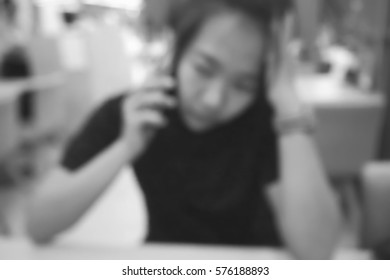 Blurred  background abstract and can be illustration to article of businesswoman use mobile phone