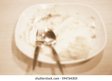 Blurred  background abstract and can be illustration to article of dish top view end of a meal