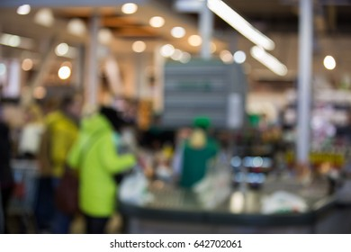 Blurred background. Abstract background of hall and supermarket checkout with bokeh effect. Defocused interior abstract texture for design.