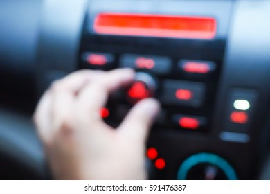 blurred  background abstract of Hand tuning fm radio button in car panel