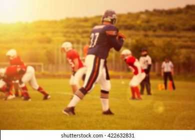 Blurred background of american football game in the sunset