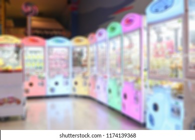 Blurred background of An arcade game or coin-op is a coin-operated entertainment machine typically installed in public businesses such as restaurants, bars and amusement arcades.