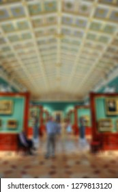 Blurred background. Art gallery with paintings.