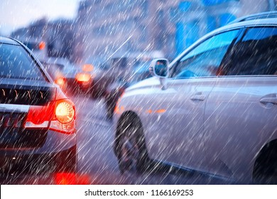 blurred background autumn auto rain on the road / night lights and raindrops in the autumn traffic jam on the road, urban style traffic