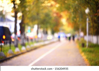 blurred background autumn street in the city