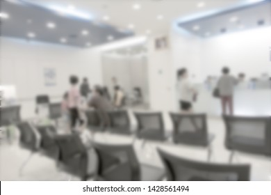 Blurred background at bank reception with people waiting