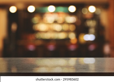 blurred background of bar and black desk space