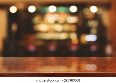 blurred background of bar and brown desk space