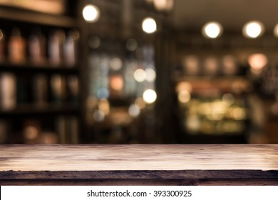 blurred background of bar and dark brown desk space of retro wood