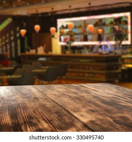 blurred background of bar and wooden board