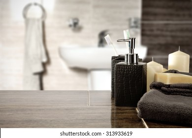 blurred background of bathroom interior and dark brown towels