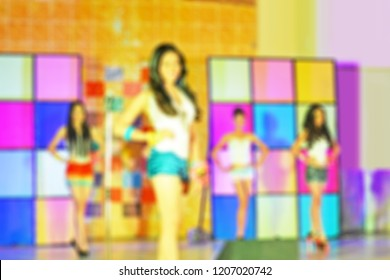 Blurred background of beautiful ladies on stage