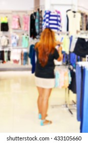 Blurred background of a beautiful lady shopping for clothes