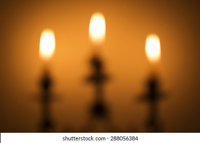 Blurred background : Blur of Candlestick with burning candles during a power outage