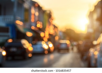 Blurred background : Blur of car on the street at old town with sunlight and golden bokeh in Phuket, Thailand