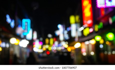 blurred background, Bokeh light,  Blurred people walking through a city street. at the night, in Seoul, Korea