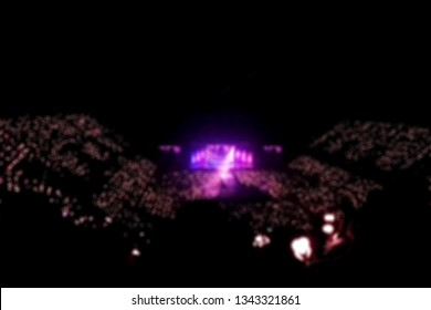 Blurred background, Bokeh, silhouette of cheering audience, lighting on the stage in indoor concert