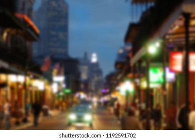Blurred background of Bourbon Street in New Orleans French quarter