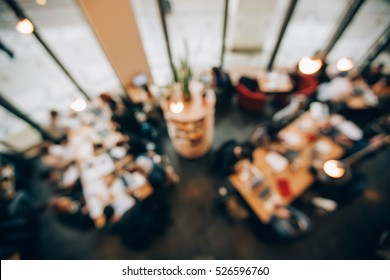 Blurred background of business people in co working office. Corporate team concept