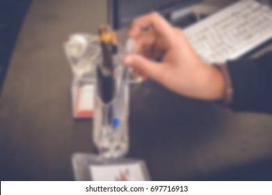 blurred background of businessman working in office