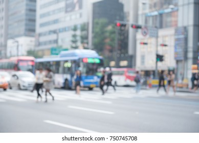 Blurred background of busy city street people on zebra crossing