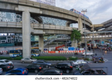 Blurred background .Busy traffic at Pathum Wan Intersection in Bangkok , Thailand