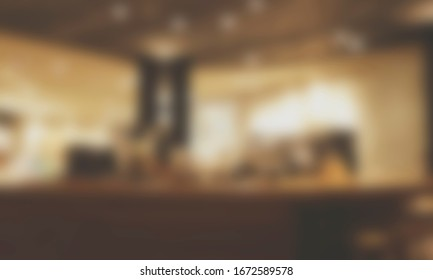Blurred background of Cafe with abstract bokeh light.