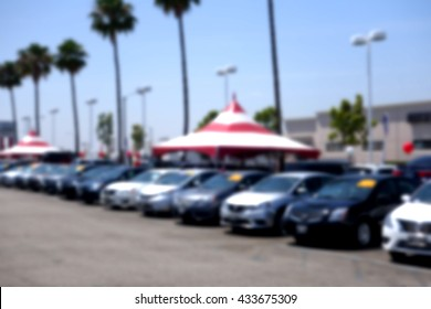 blurred background of car dealership lot