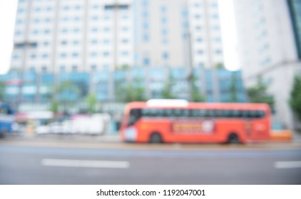 Blurred background of car driving on the road, traffic in the city, side view