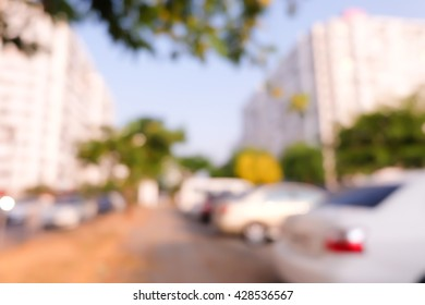 blurred background of car in parking lot .
