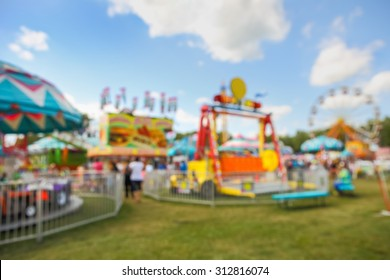Blurred background of a carnival midway.