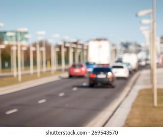 Blurred background of cars on asphalt road