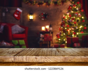 Blurred background of christmas tree with bokeh in front of wooden table