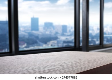 blurred background of city and dark desk space