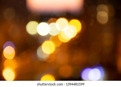 Blurred background, city lights, night time