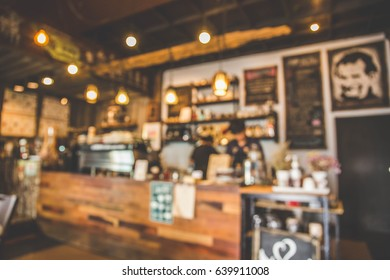 Blurred background coffee shop bar interior. blur background with bokeh. vintage tone.
