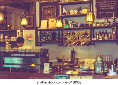 Blurred background coffee shop bar interior and people. blur background with bokeh. vintage tone.concept use for background.