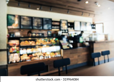 Blurred background Coffee shop interior with Vintage Tones