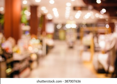 Blurred background of colorful and freshness modern retail , department store or shopping mall with natural bokeh light. For your outstanding retail background and business project design.