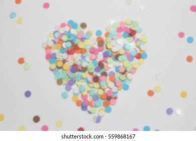 Blurred Background. Colorful polka dot papers with heart shape on white background.Love and care concept. Valentine's day.
