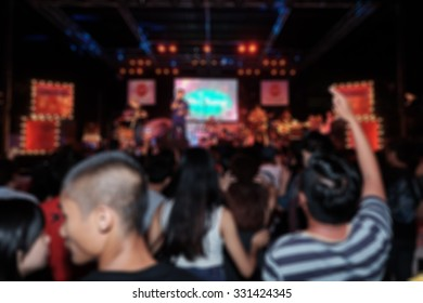 Blurred background in concert / Abstract lighting blur in concert / asian people