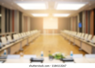 Blurred background of the conference room or seminar meeting room.