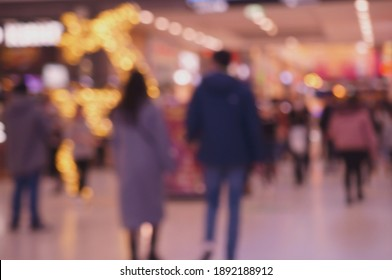 Blurred background. A couple of young people in a shopping center.