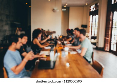 Blurred background of co-working space with team building. Team working concept.