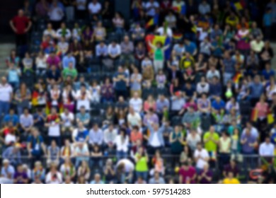 blurred background of crowd of people in a sports arena