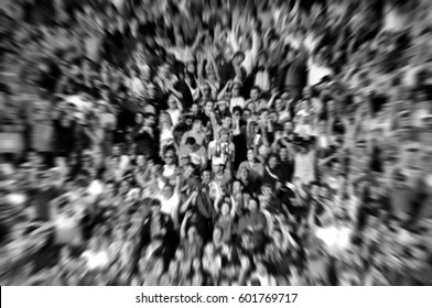 Blurred background of crowd of people in a stadium at a footbal match