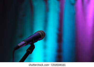 blurred background curtain of different colors, in the foreground microphone