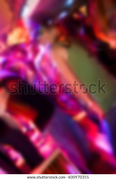 Blurred background with dancing people in nightclub.Out of focus back ground with night club crowd dancing.Motion blur effect